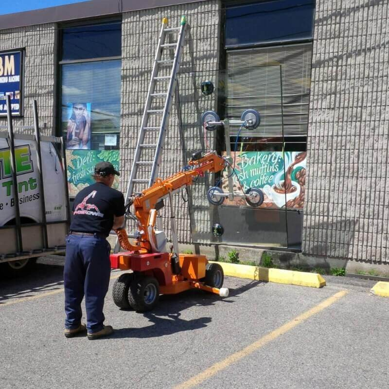 All-Brite Glass & Tint technician replaces a window on a commercial building