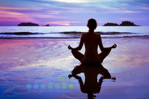 Photo of woman on purple sunrise beach in lotus position