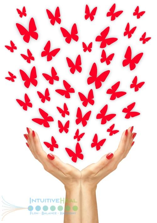 Image of hands releasing red butterflies