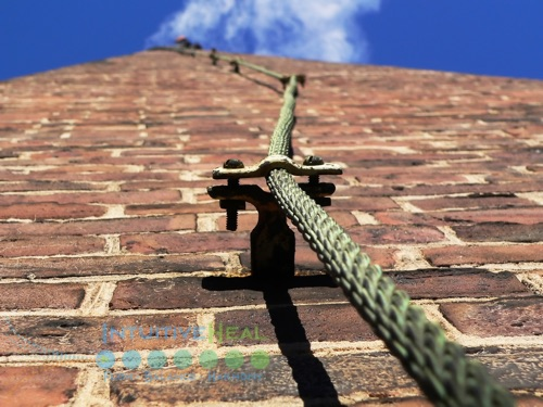 Photo of rope head up brick building to the sky