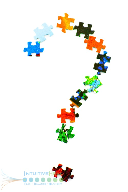 Image of colorful puzzle pieces forming a question mark