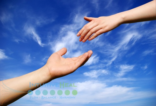 Photo of two hands reaching for each other against sky background