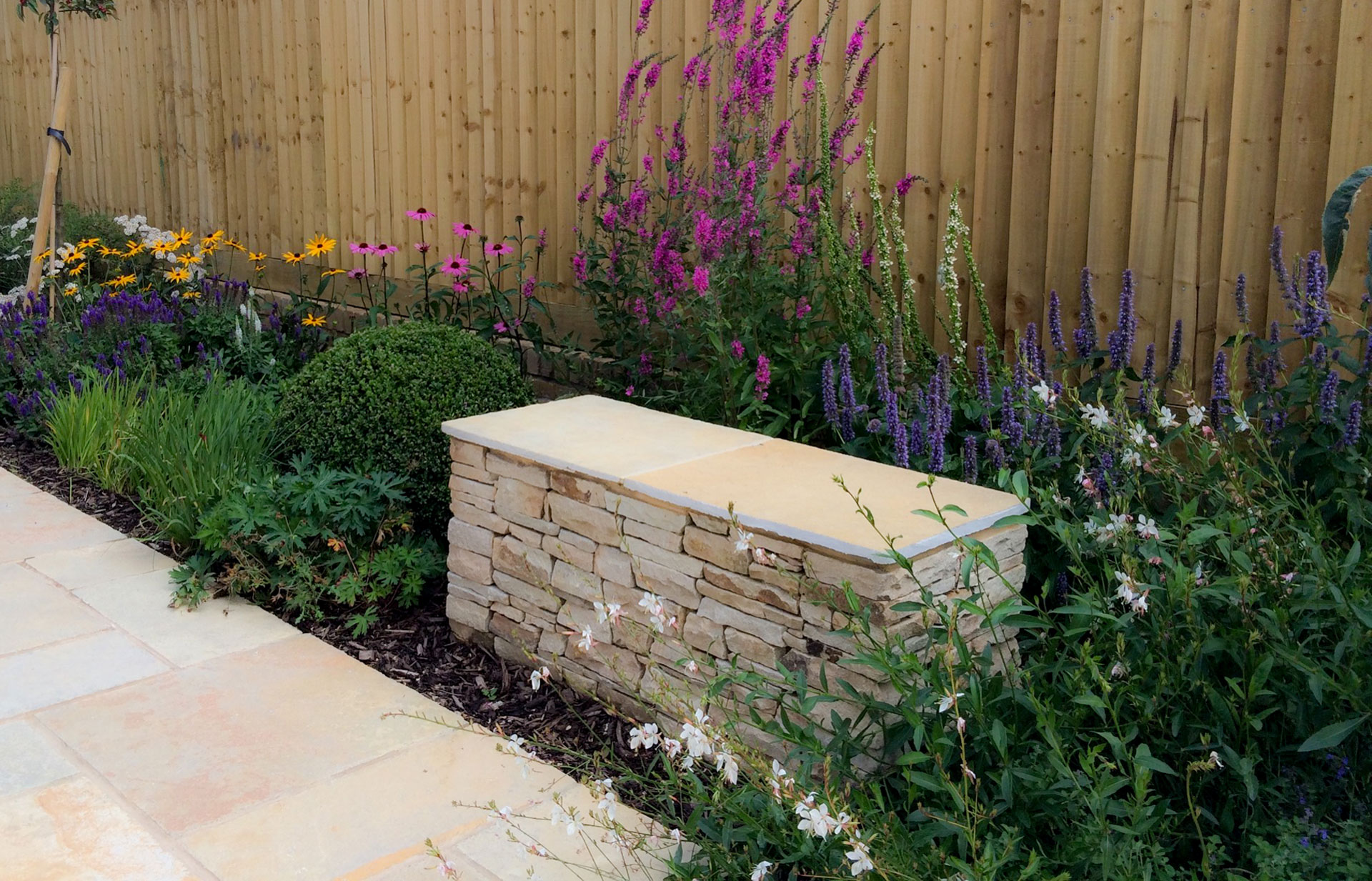Stone Bench Surrounded By Flowers