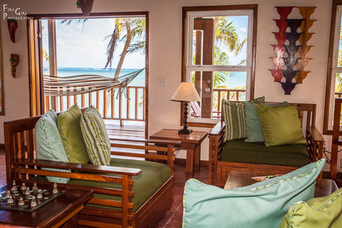 photo of belize hardwood furniture in the living room area overlooking the veranda and ocean