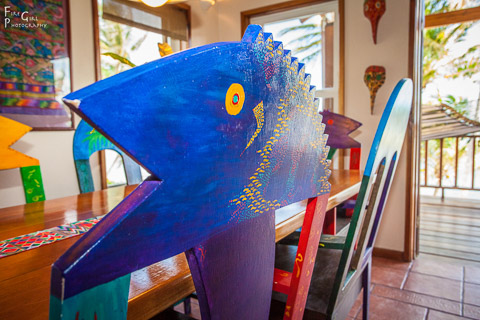 Each villa features unique local artist pieces like this dining chair.