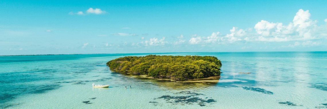 Photo if Guide and Angler fishing a small island near Ambergris Caye, Belize