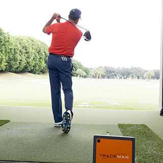 Man driving golf ball