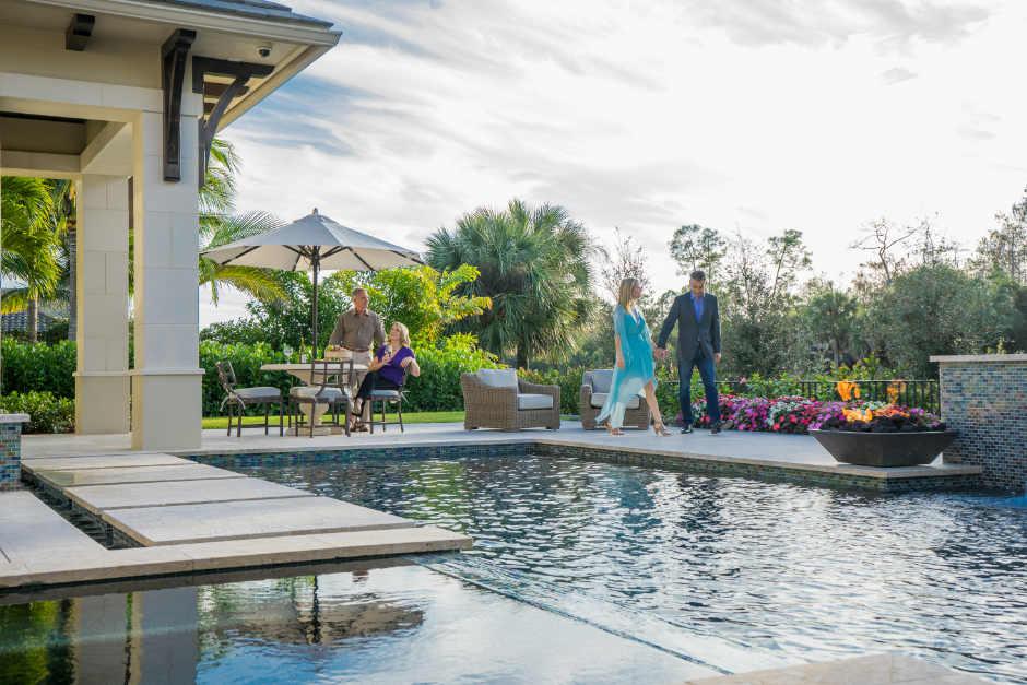 couple walking around pool