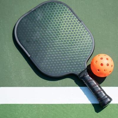 Pickleball racquet and ball