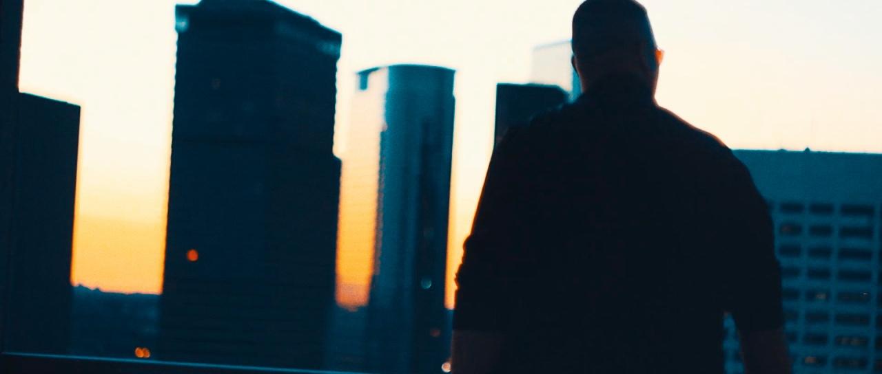 man overlooking Houston downtown