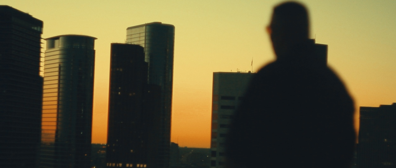 a man overlooking Houston downtown skyscrapers