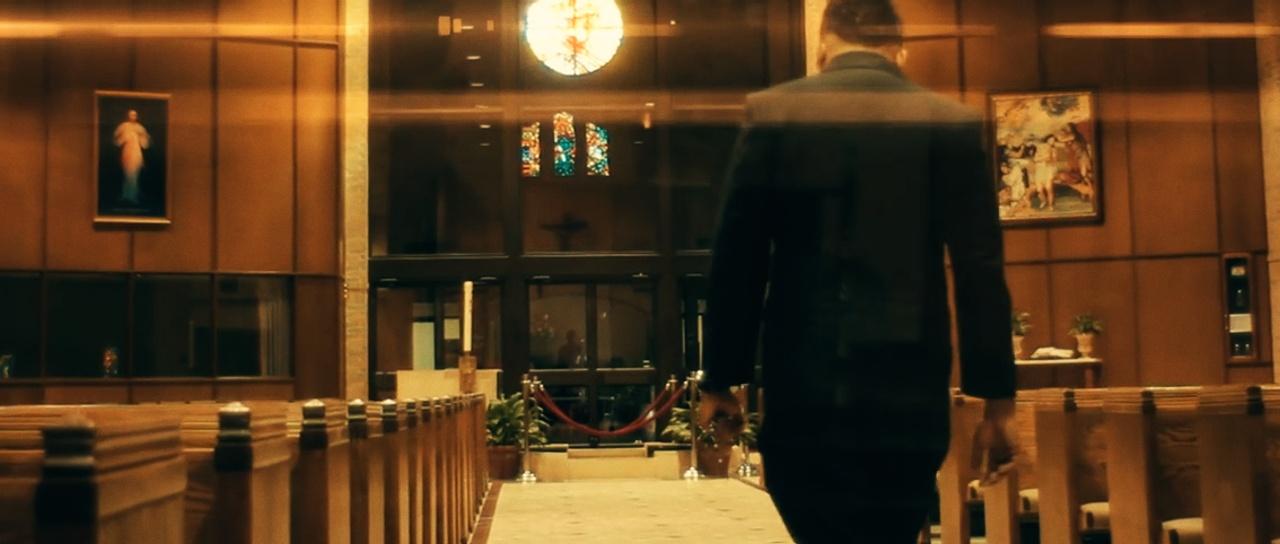 a man walking down a church aisle