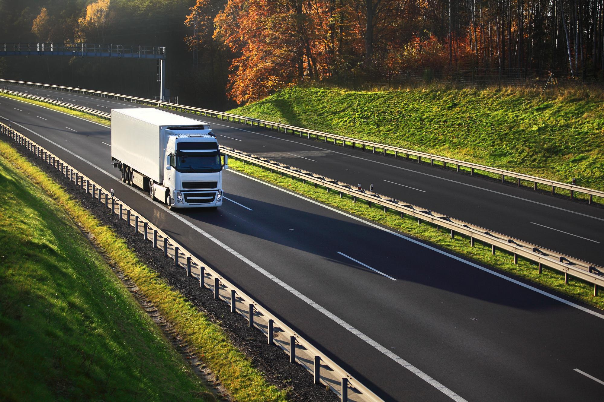 A semi truck driving along a highway