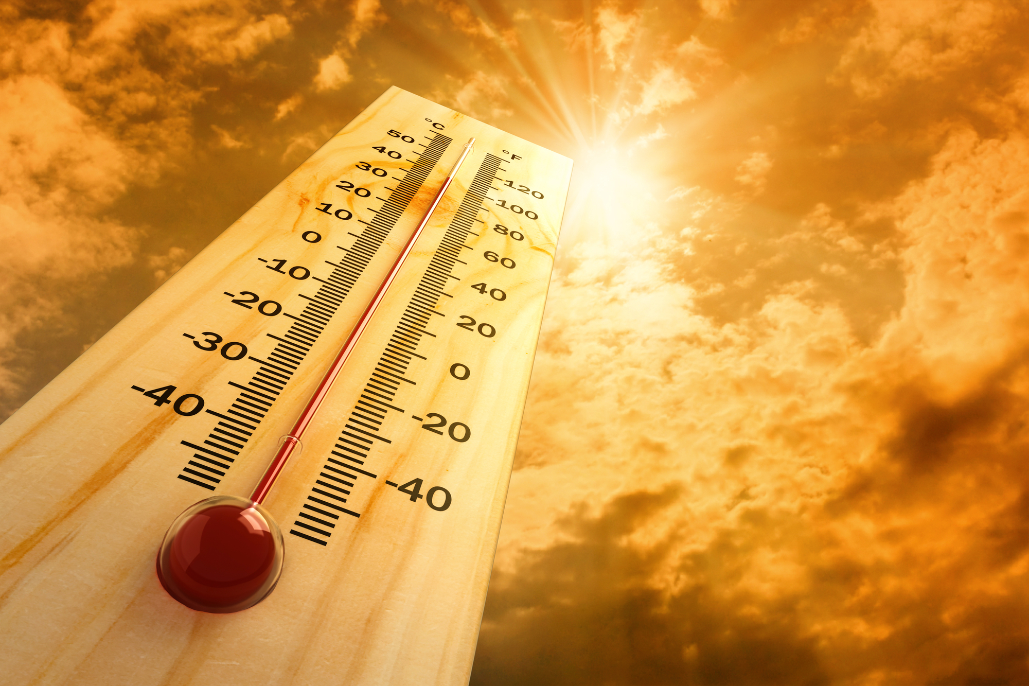 A thermometer rises in hot weather