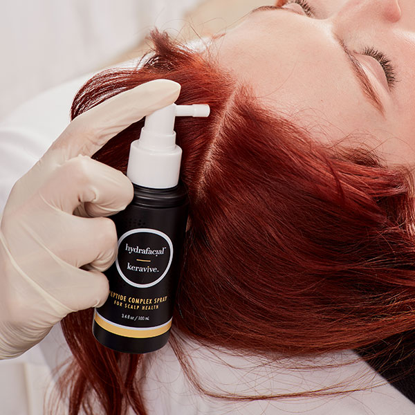 keravive product being applied to scalp