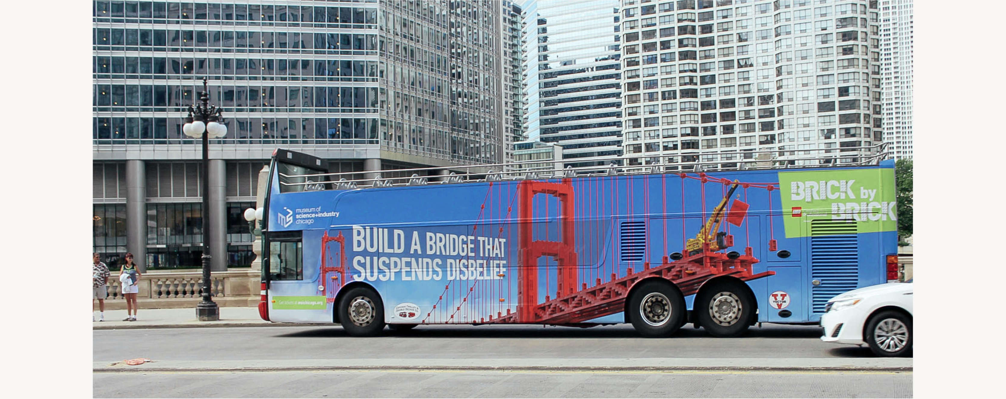 Out of home bus wrap ad featuring LEGO Golden Gate bridge.