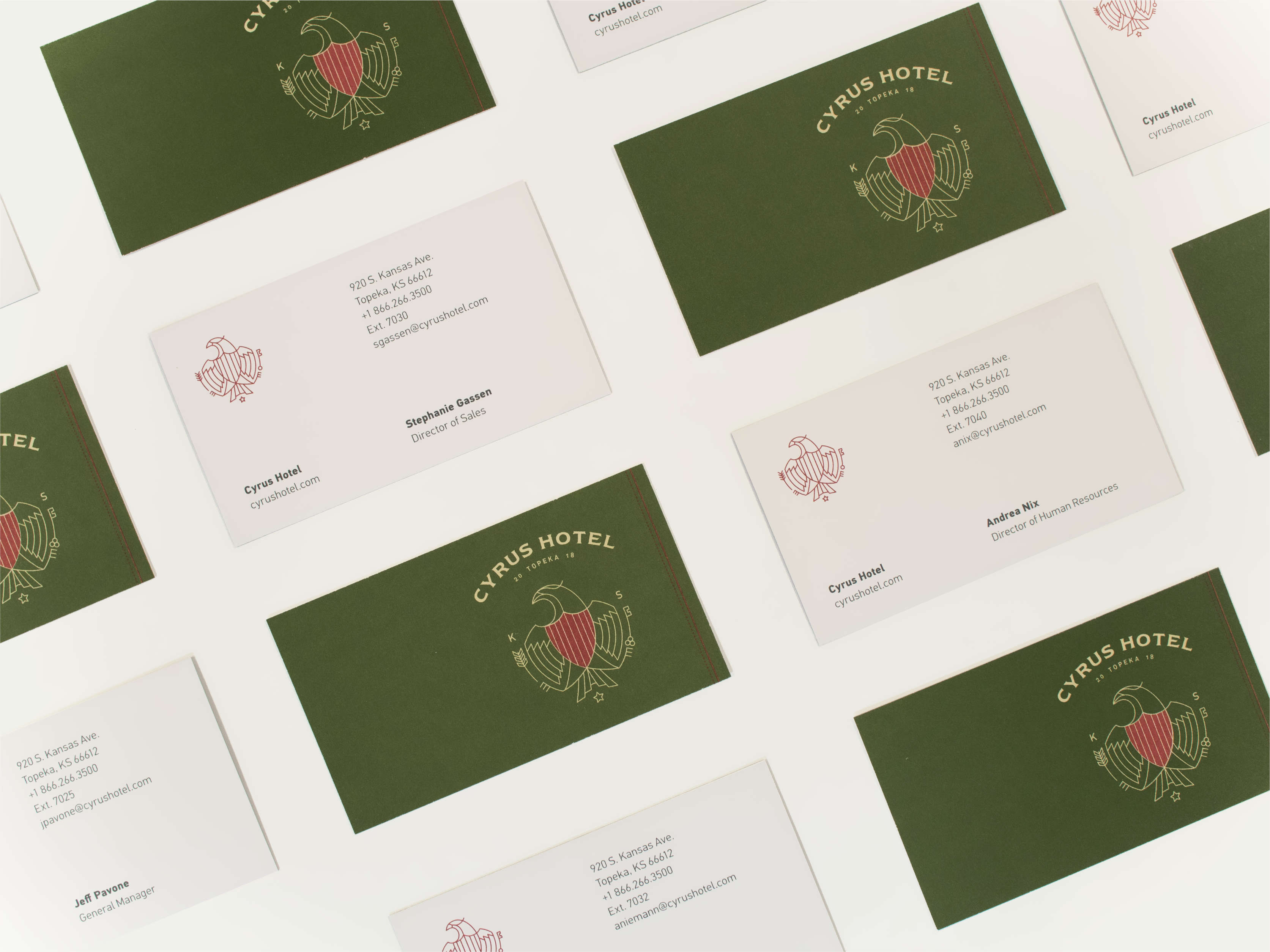 Spread of Cyrus Hotel business cards.