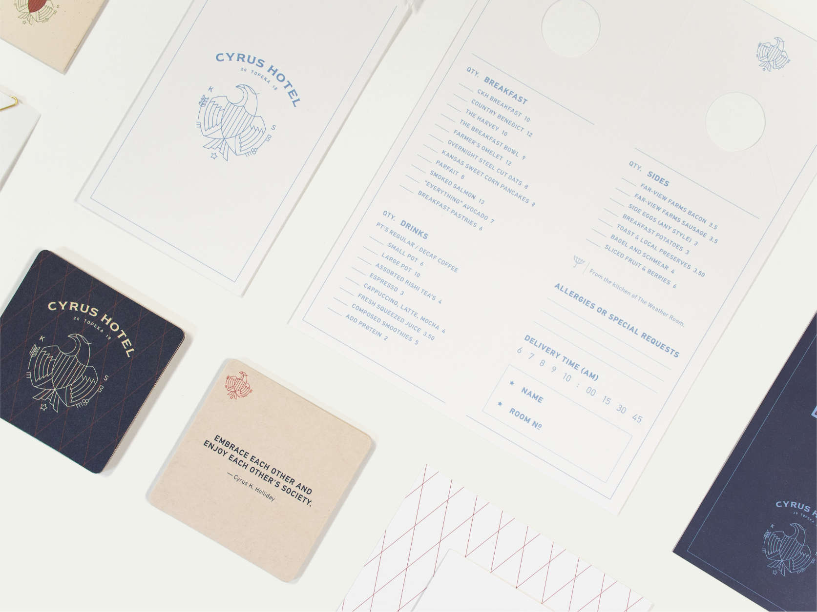 Spread of Cyrus Hotel print collateral, including coasters and door hanger menu.