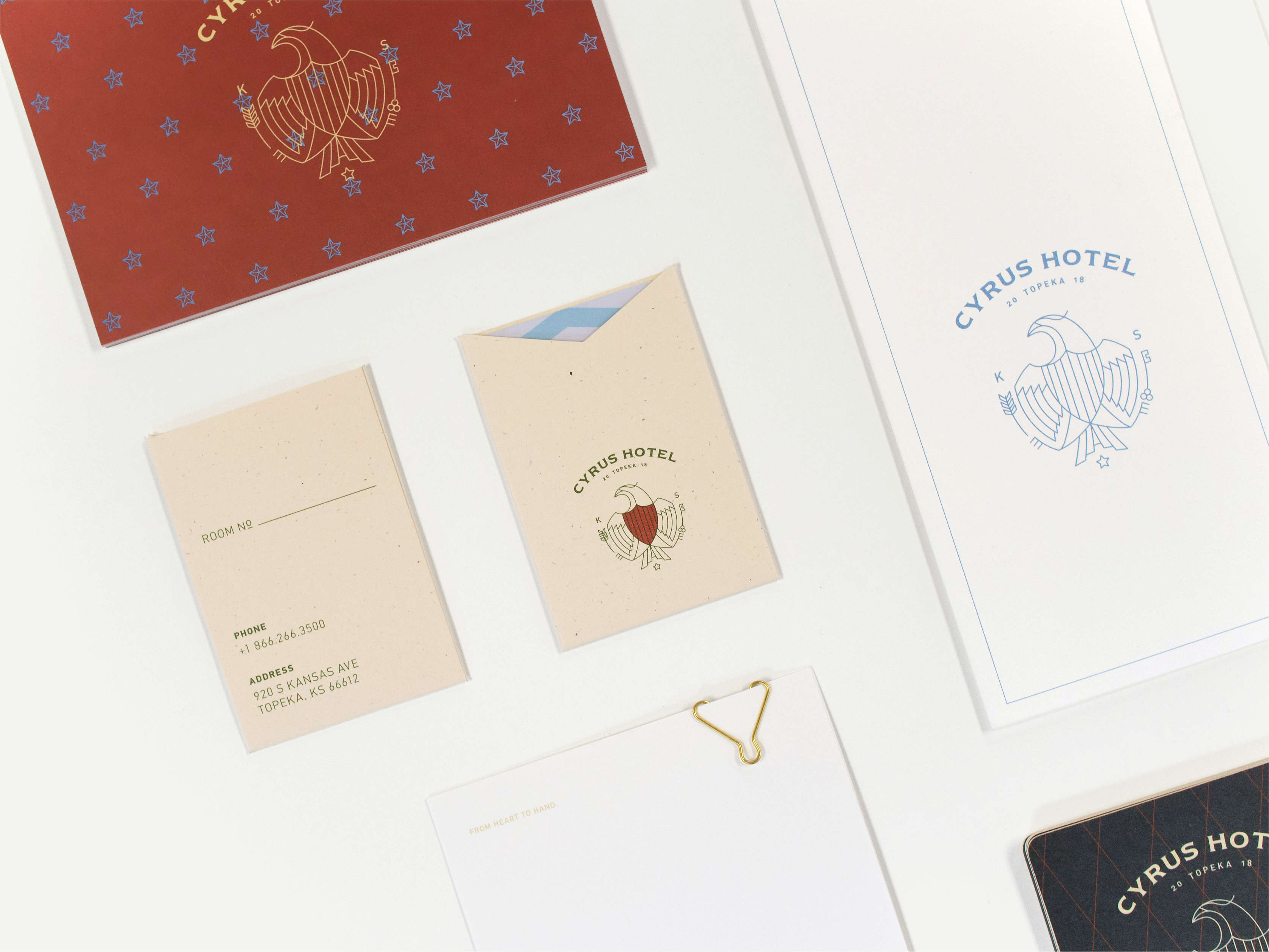 Spread of Cyrus Hotel print collateral, including room key card, post card, and note pad.