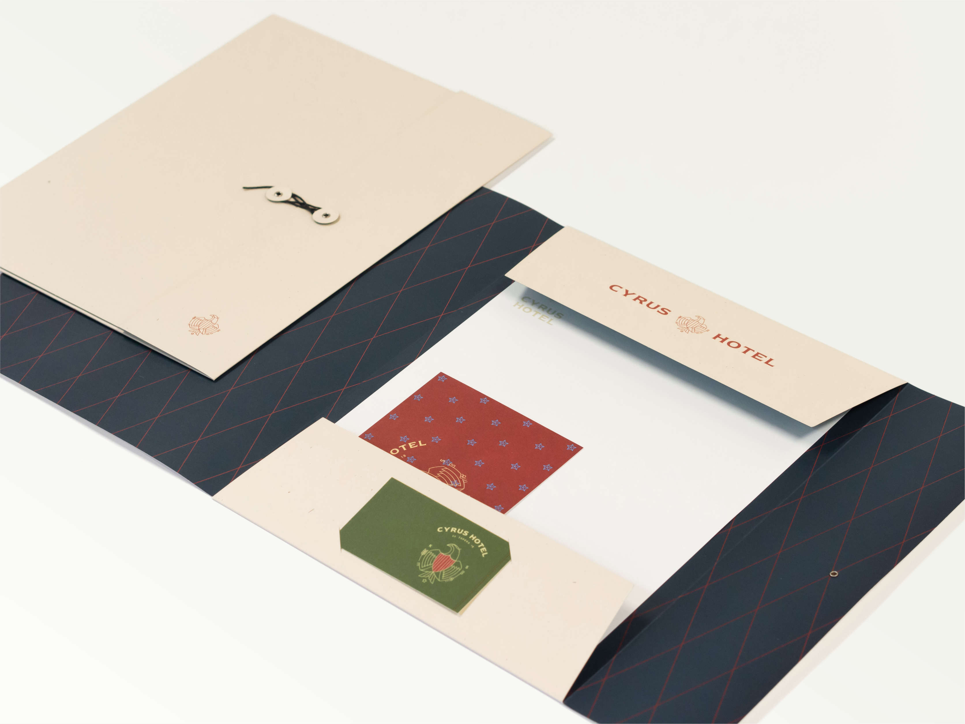Spread of Cyrus hotel guest room compendium and envelope.