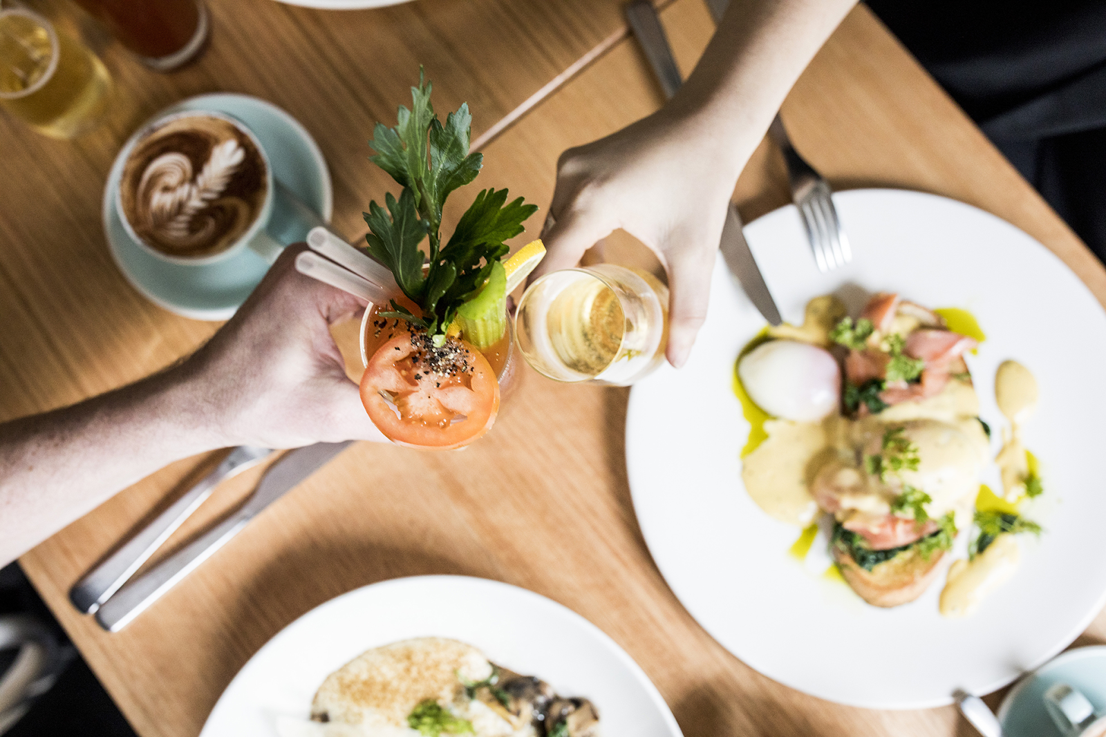 Cheering Bloody Mary and champagne over brunch dishes