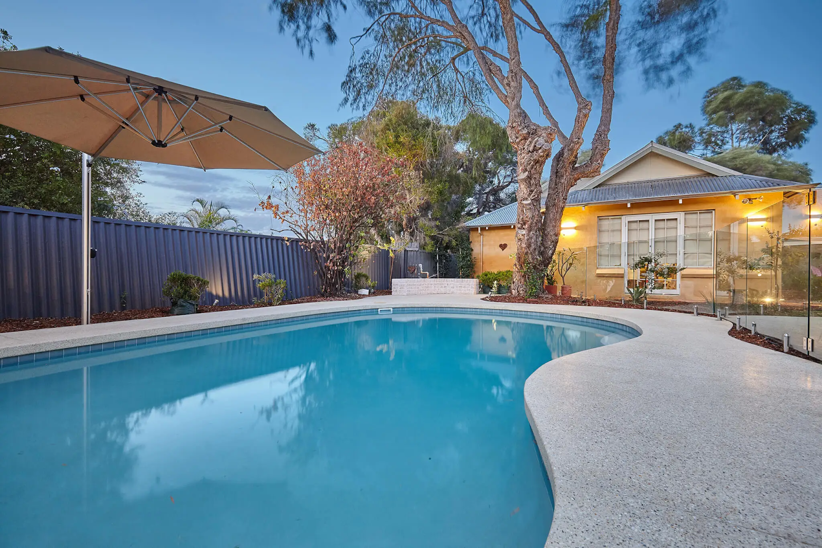 Pool area with concrete surrounds