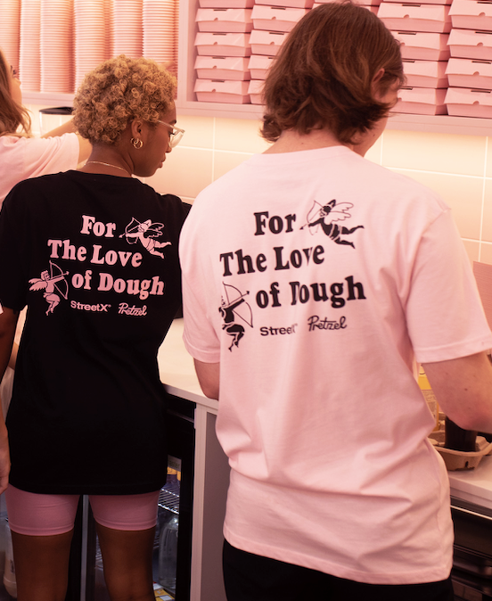 Image of two people wearing the tee, from the back