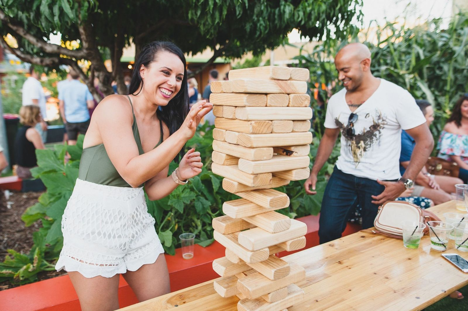 man and woman playing giant jenga