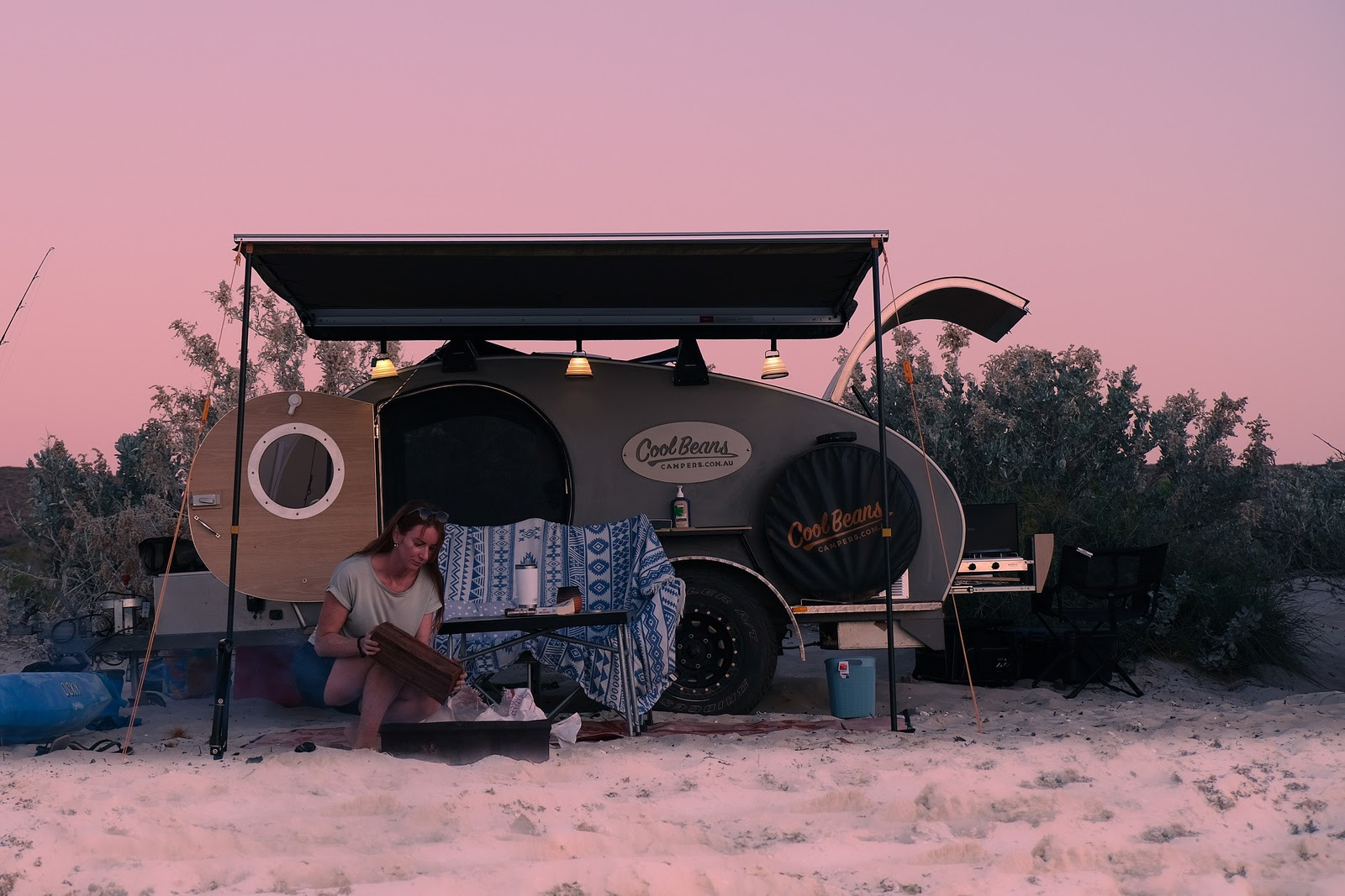 campervan parked on beach at sunset
