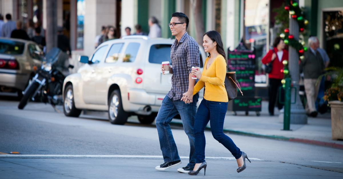 couple walking across a street