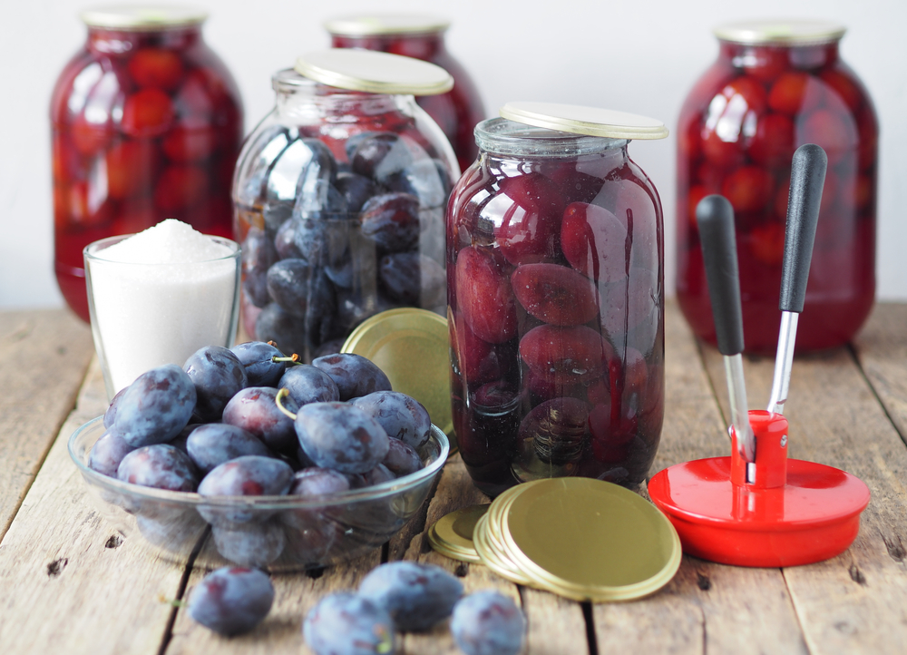 The process of canning plum compote in glass jars