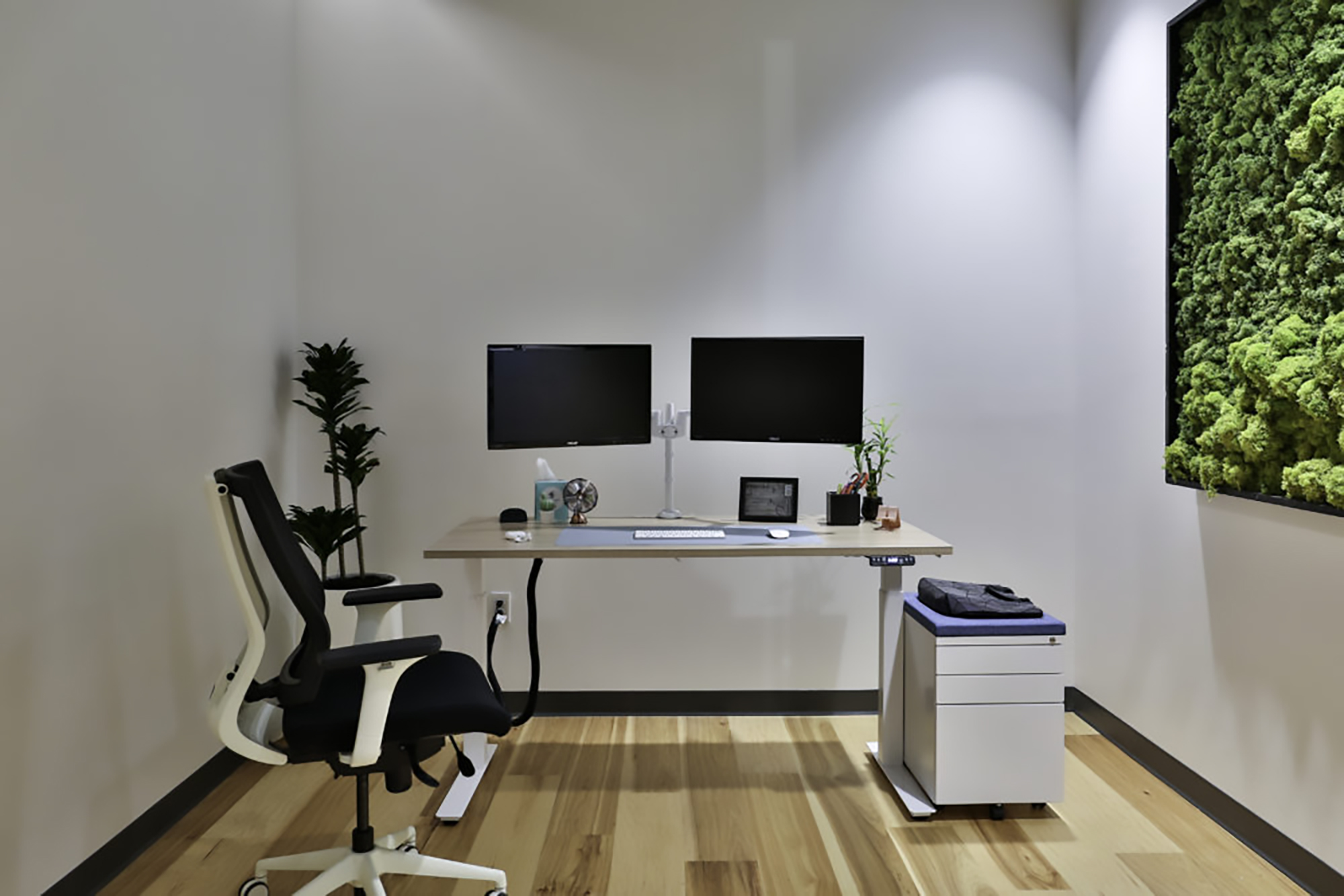 """For those who prefer standing, Clear Design's Boost height-adjustable table desk and the Versteel Sky (pictured at top) offer heights ranging from 27"""" to 44.5"""" with a dual-stage digital handset. Don't forget the monitor arm to help maximize your desk space and storage for underneath."""