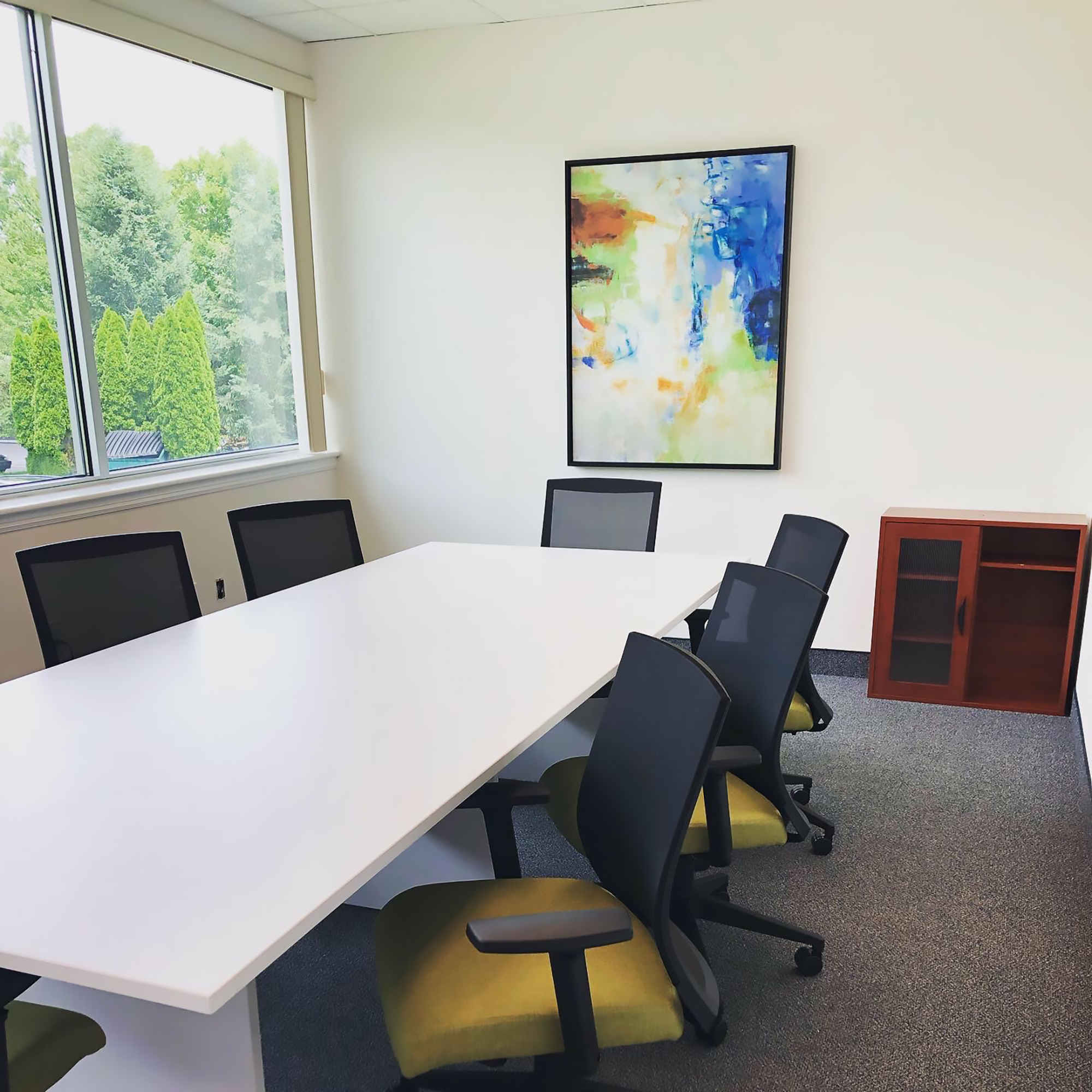 Blending art with the natural beauty outside their window enhances this client's conference room.