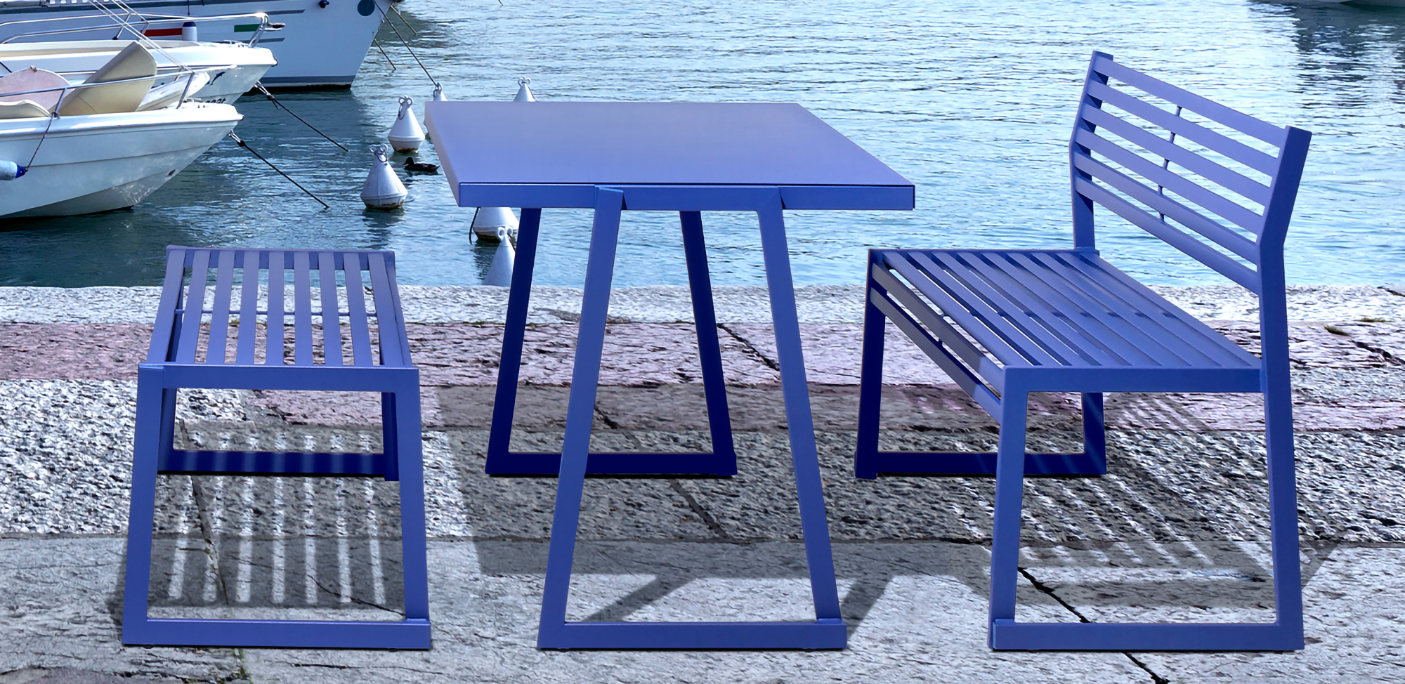 The Cortina table by Via stacks 6 high! Designed and warrantied for use in extreme conditions with salt-water air and high heat and humidity, it's the ideal outdoor solution.