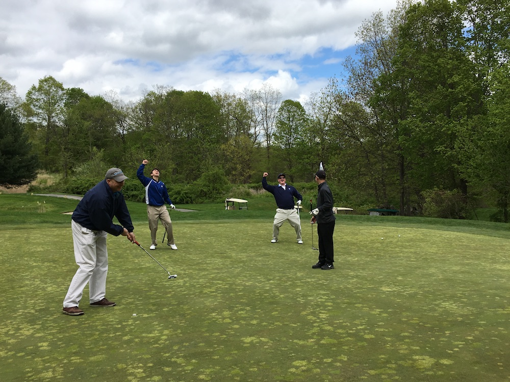 Attendees playing golf