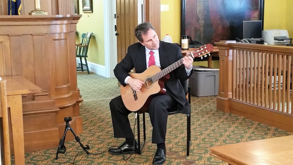 man playing guitar at Law Day Celebration