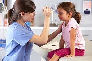 Nurse providing compassionate care to child patient