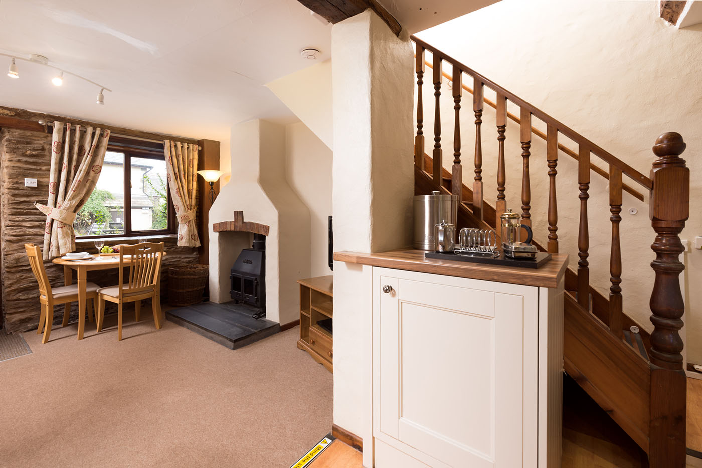 Hayloft living area and kitchen with stairs