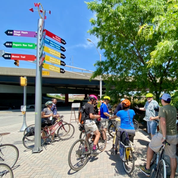 Attendees stop at the urban trailhead for the Monon Trail, the legendary spot where Brian Payne was inspired to start the Indianapolis Cultural Trail