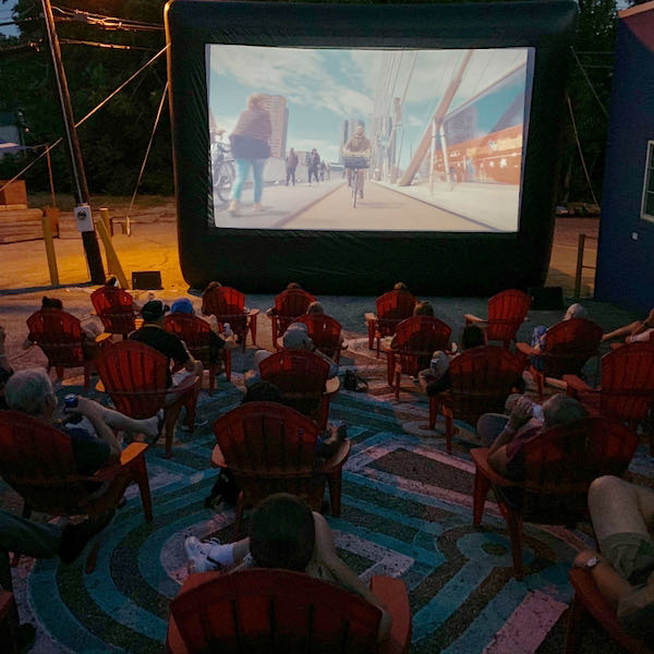 Participants capped off the closing party with a screening of Together We Cycle, a documentary about the Dutch cycling advocacy movement. Photo courtesy of Christian Huelsman, Spring in Our Steps