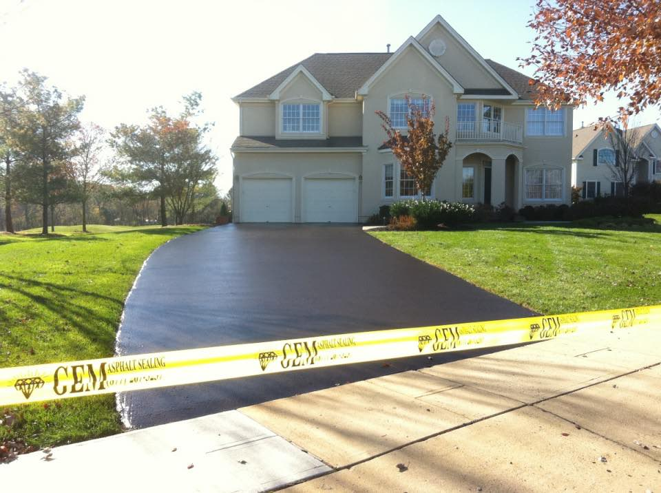 A driveway in Princeton NJ restored with asphalt sealing