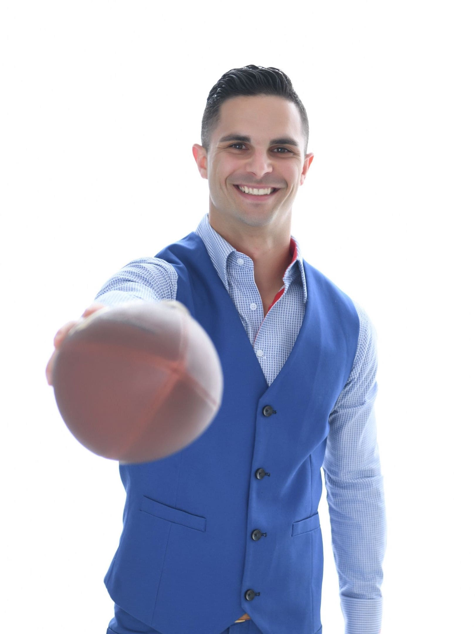 Photo of Richie holding a football in front of him