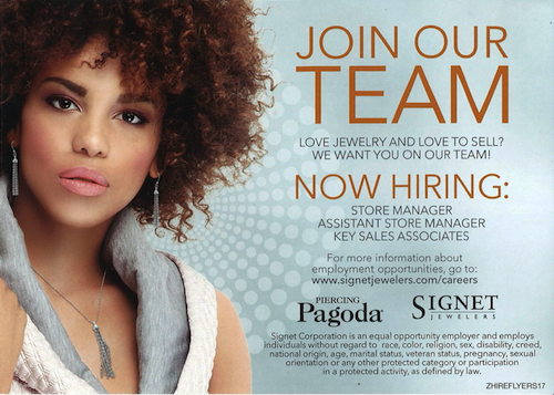 Curly haired model with silver earrings and hiring information for Piercing Pagoda