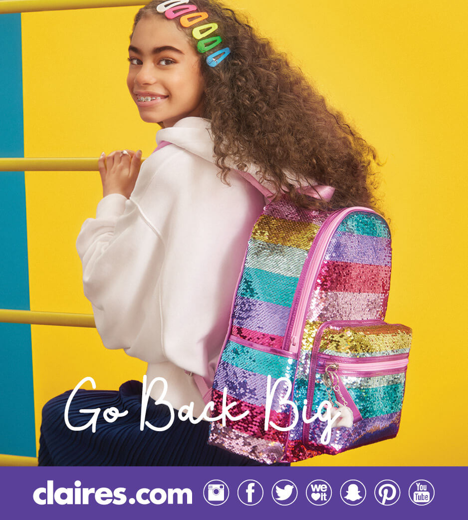 Girl wearing rainbow hair clips and a rainbow sequin backpack