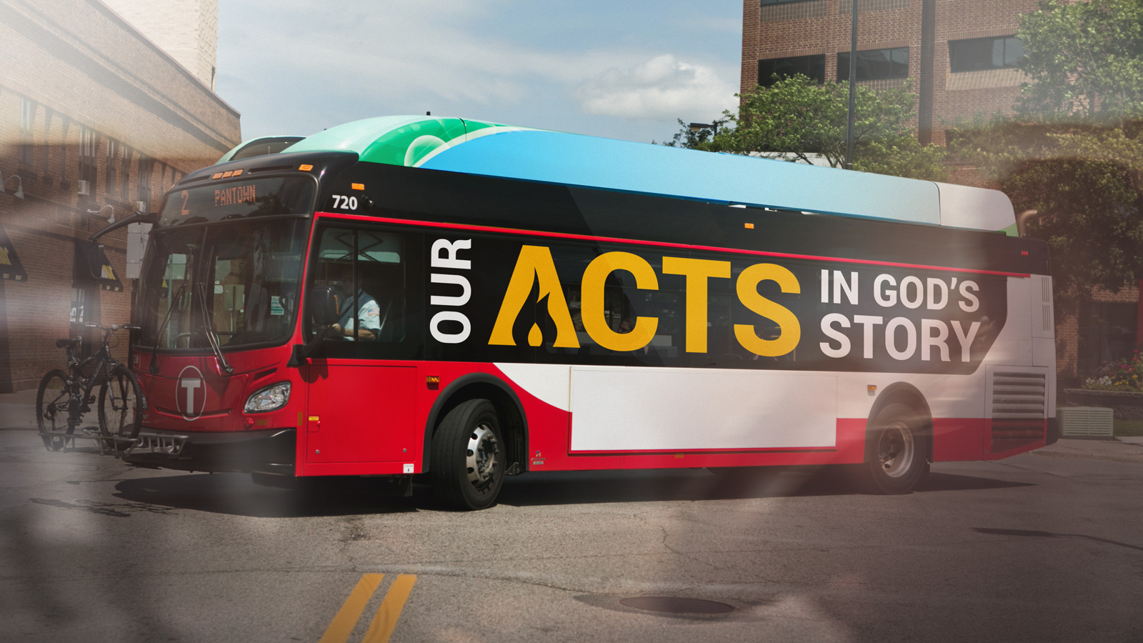 """A bus wrap with the text """"Our Acts in God's Story"""""""