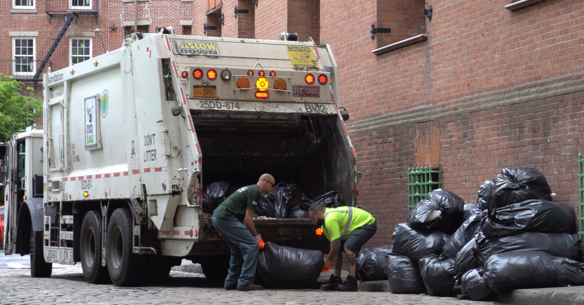 garbage men taking out trash