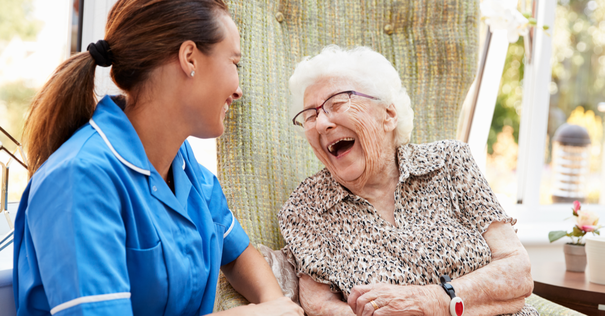 a nurse and an old lady laughing together