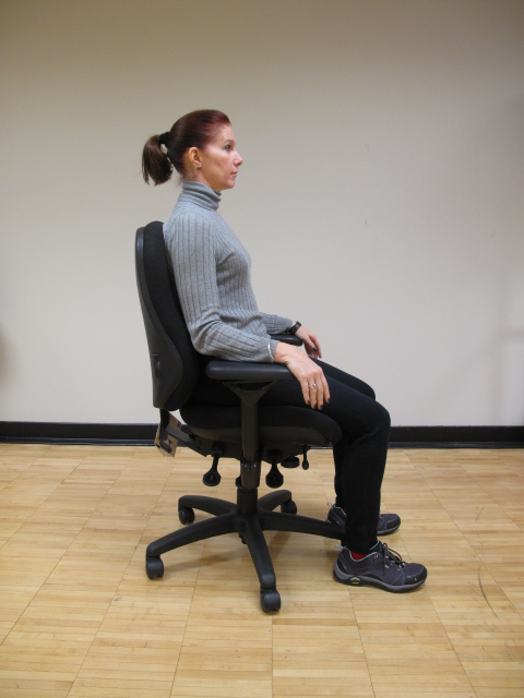 girl sitting in chair with good posture