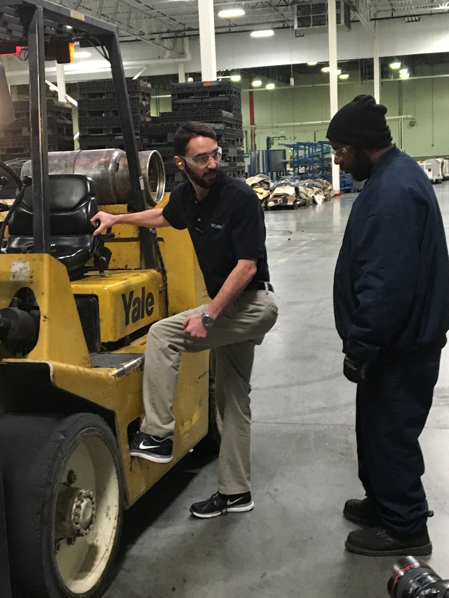 person instructing someone else on the forklift