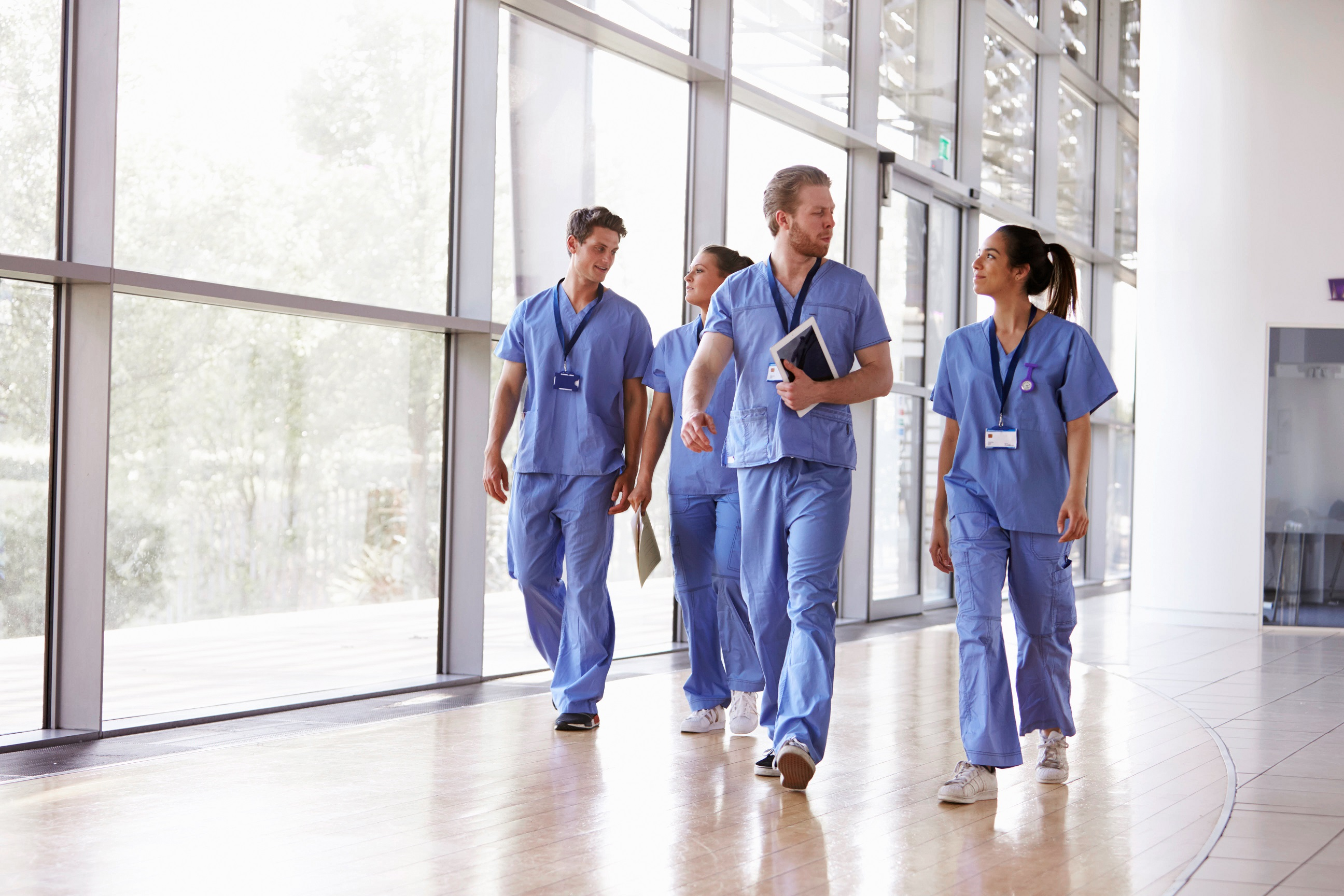 Healthcare workers walking down hallway